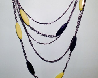 Avant-Guarde Jewelery - An eye-catching necklace featuring cut acrylic ovals in lime green & jet black.