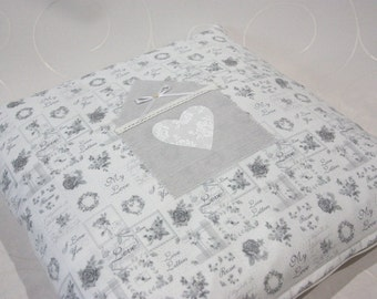 Fine pillows including filling with House and heart application