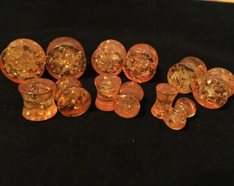 Synthetic amber plugs