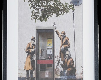 Framed 'Banksy Spy Booth' picture