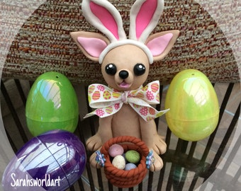 Easter themed Cute Chihuahua model, wearing bunny ears, with a basket of Easter eggs.
