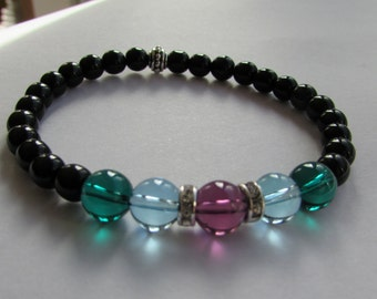 Stretch bracelet with Swarovski crystal globes