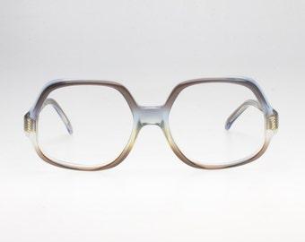 Safilo elasta. Grandma style. Clear/blue/brown. Flex hinges. Seventies oversize shape.