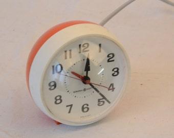 General Electric orange round alarm clock