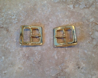 Gold belt buckles