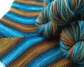 Hand dyed self striping merino sock yarn - Ship Graveyard