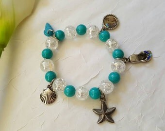 Stretchable beach beaded bracelet with charm. glass beads