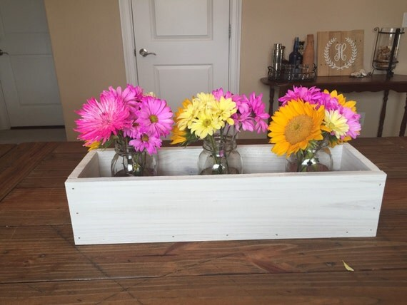 White washed wood trough centerpiece with by