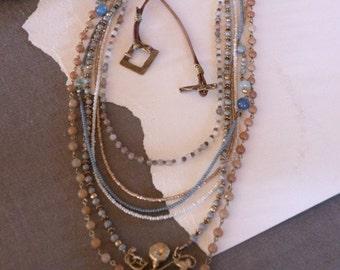 Gemstone multi-strand necklace with brass charm