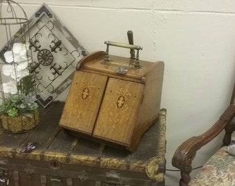 Vintage ash box,ornate wood and brass work.