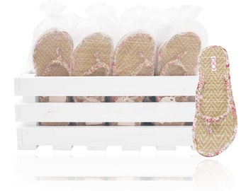 30 pairs of pink beach matt style flip flops presented in a beautiful crate