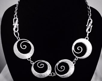 Silver Swirls Bib Necklace