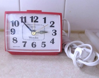 A Cute Vintage 80's,Red Plastic Plug in ALARM CLOCK by WESTCLOX.