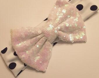 White polka-dot bow