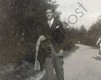 Vintage Snapshot - 1940's 1950's - Man Walking, Carrying Jacket, Dirt Road, Sunny Outside, Trees