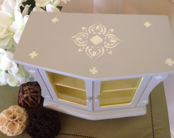 Grey and white jewelry box with stenciling.