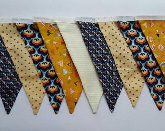 A mustard, orange and blue retro geometric fabric bunting banner