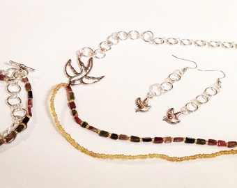 Tourmaline gemstone necklace set featuring birds