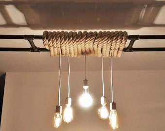Chandelier in cast iron pipe and rope