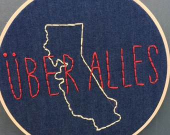 "8"" Hoop Art Embroidered ""Uber Alles"""