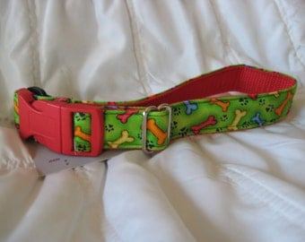 Cute dog collar with bright green background and multi-colored bones.