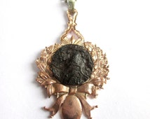 Reclaimed Antique Petrified Metal on a Medal Necklaces