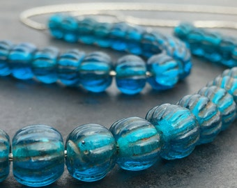 Teal necklace of antique Chinese glass melon beads on sterling chain. Extraordinary beads!