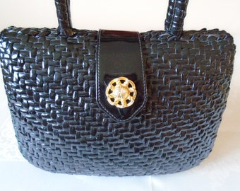 black woven and bonded day bag