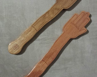 A hand shaped spanking paddle from Hanky Spanky Oz