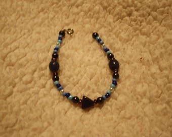 Blue, White, and Black Beaded Bracelet