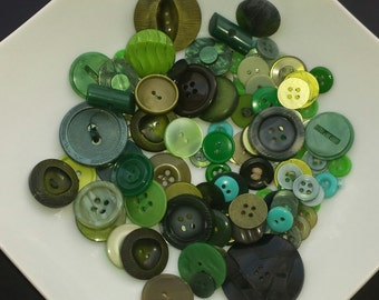 Lot of different colours green vintage buttons