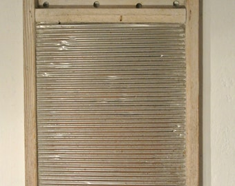 Antique washboard with wood frame