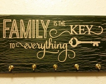 "Green ""Family is the key to everything"" key hanger sign"
