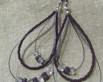 Three strand purple dangle earrings