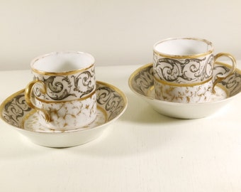 Pair of XVIII th century Brussels porcelain coffee cups and saucers