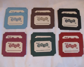 Set of 12 hand stamped hand knit tags