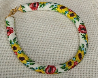 Beaded cord necklace with sunflowers and poppies