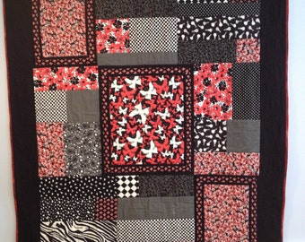 Black, red and white quilt