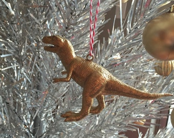 Gold dinosaur ornament