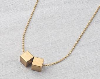 Chain brass dice geometric/minimal