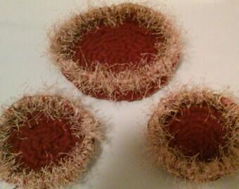 Three fuzzy yarn baskets.