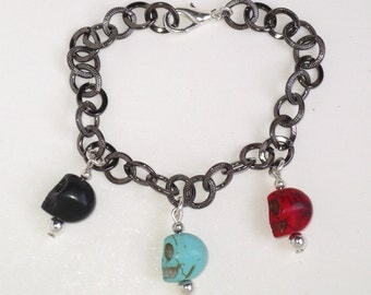 GJ Party Skulls charm bracelet on black chain with silver accents