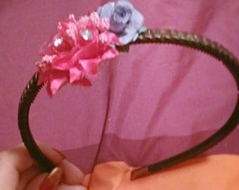 brown headband with pinik and blue flowers