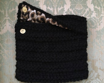 Knitted black case with leopard print lining.