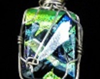 Glass pendant with silver wire wrapping.
