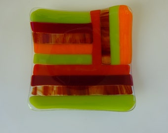 Fused glass plate with green, orange and red stripes