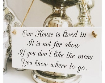 Our house is lived in, it's not for show plaque sign