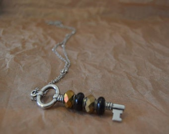 Black and gold key pendent necklace
