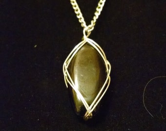 Wire wrapped black glass pendant