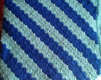 Large crocheted 2 shades of blue baby blanket